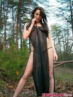 Naughty brunette ex-girlfriend slut Rebecca strips black babydoll and shows boobies in the woods