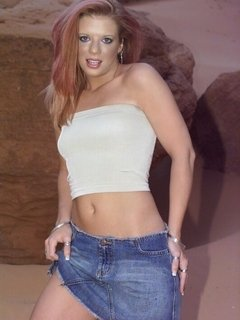 Redheaded ex-girlfriend slut Sabrina Stern strips mini jeans skirt and flashes hot body on the rocks