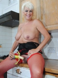 Dimonty in the kitchen fucks with a cucumber and a banana. See them pused in and against her wet pussy.