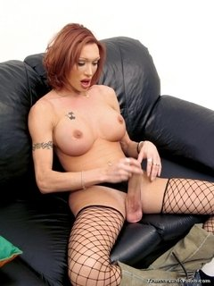 Redhead malebitch wanking off her gorgeous cock in her black net stockings.