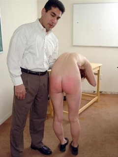 Pretty redhead stripping off in front of her class to get ass caning from her professor