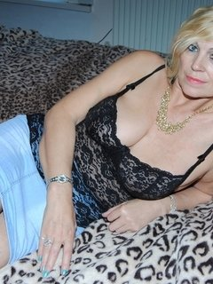 Pictures of Platinum Blonde's black knickers up her short blue skirt.
