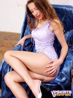 Brown haired goddess strips seductively her purple dress and rubs her pink pussy